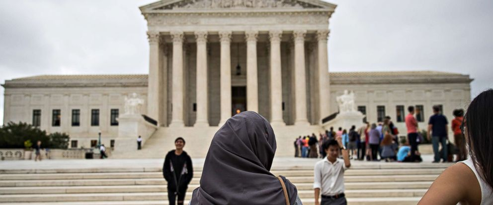 PHOTO: A woman wearing a hijab stands outside the U.S. Supreme Court, Oct. 11, 2017 in Washington, DC.