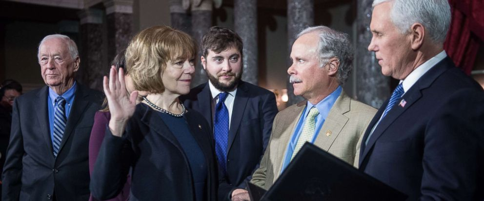 PHOTO: New Democratic U.S. Senator from Minnesota Tina Smith (2nd L) is ceremonially sworn in by Vice President Mike Pence at the Capitol in Washington, Jan. 3, 2017, as her father F. Harlan Flint (L), son Sam Smith (C) and husband Archie Smith look on.