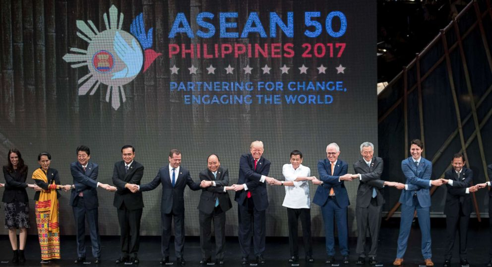 PHOTO: President Donald Trump, center, and other leaders do the ASEAN-way handshake on stage during the opening ceremony at the ASEAN Summit at the Cultural Center of the Philippines, Nov. 13, 2017, in Manila, Philippines.