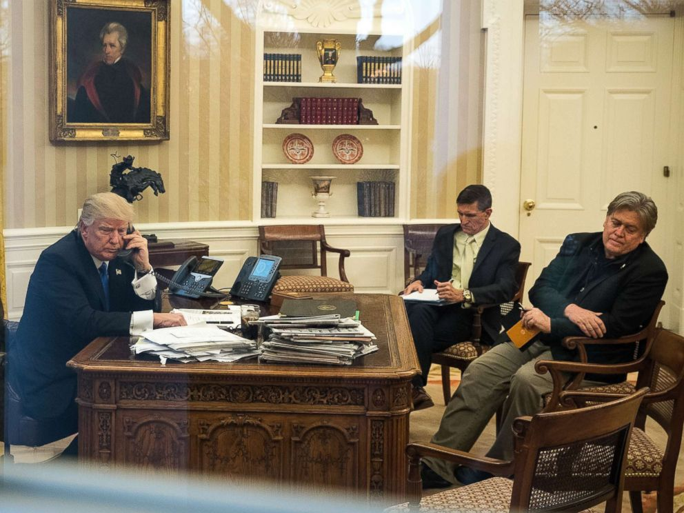 PHOTO: President Donald Trump speaks on the phone with Australian Prime Minister Malcolm Turnbull in the Oval Office of the White House, Jan. 28, 2017. National Security Advisor Michael Flynn and White House Chief Strategist Steve Bannon were present.