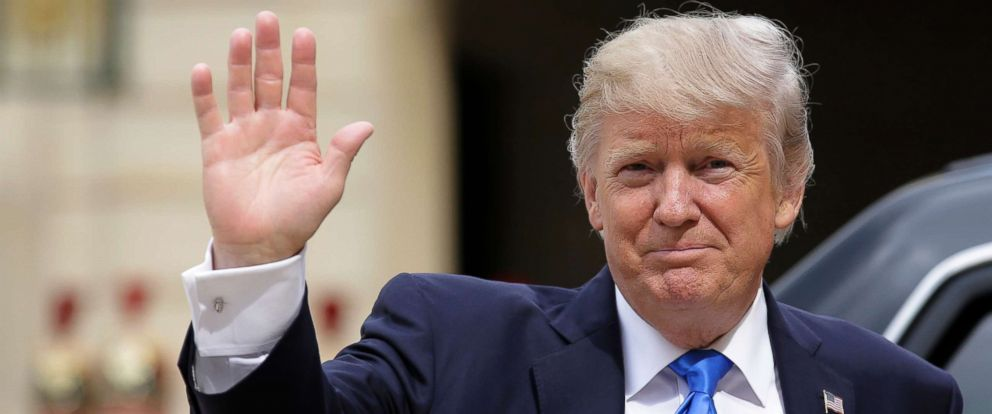 PHOTO: President Donald Trump waves as he arrives for a meeting with French President Emmanuel Macron at the Elysee Palace in Paris, July 13, 2017.