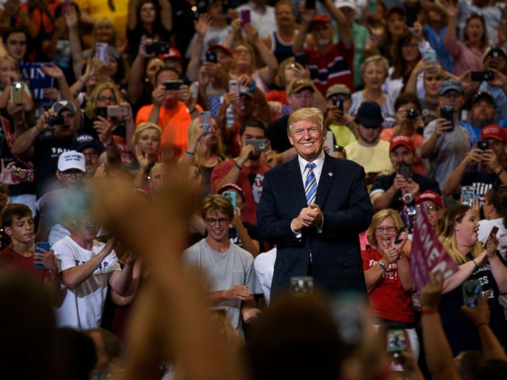 PHOTO: President Donald Trump listens as a crowd cheers his arrival at a campaign rally at the Big Sandy Superstore Arena on Aug. 3, 2017 in Huntington, W. Va.