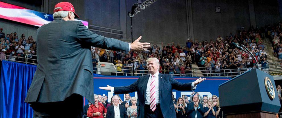 PHOTO: Alabama state Republican Senator Luther Strange, left, walks to embrace President Donald Trump during the senators rally at the Von Braun Civic Center September 22, 2017 in Huntsville, Ala.