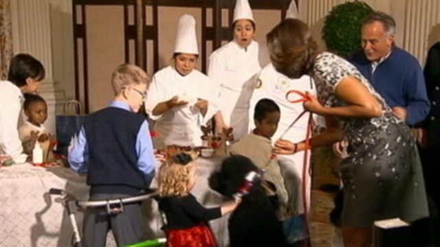 VIDEO: The newest member of the Obama family helped the first lady spread holiday cheer.