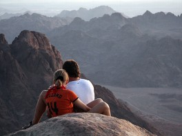 PHOTO  Two tourists take in the view of the mountains surrounding Gebel Musa as the sun rises.