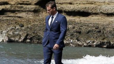 "PHOTO: Juan Pablo Galavis walks along the beach during the season finale of ""The Bachelor."" During the episode, which aired March 10, 2014, he was forced to choose between two women, Clare and Nikki."