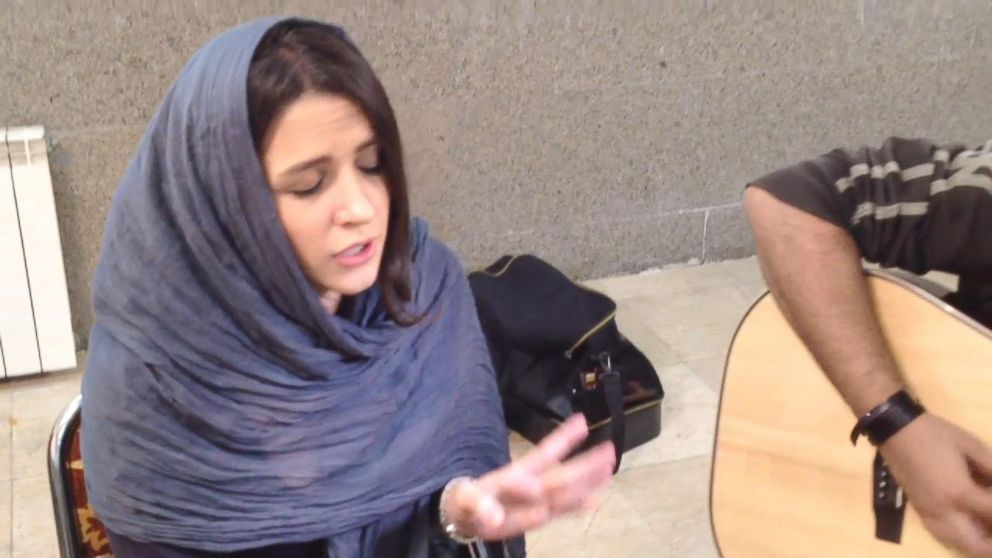 "PHOTO: Azadeh Ettehad, 27, sings Adeles ""Rolling in the Deep."""