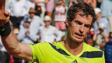 PHOTO: Britains Andy Murray shakes hands with referee Damien Dumusois of France after losing the semifinal match of the French Open tennis tournament in Paris, France, June 6, 2014.