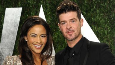 PHOTO: Paula Patton and Robin Thicke arrive at the 2013 Vanity Fair Oscars Viewing and After Party at the Sunset Plaza Hotel in West Hollywood, Calif.