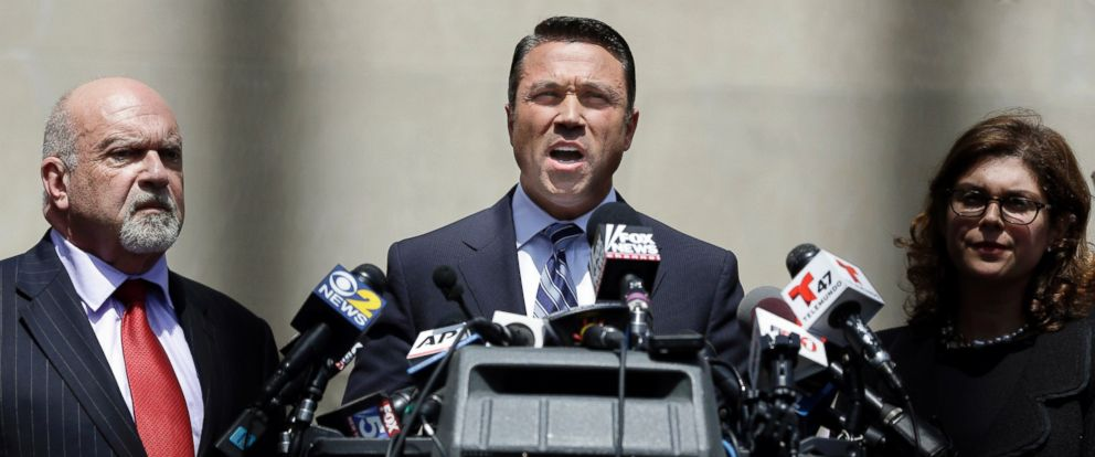 PHOTO: U.S. Rep. Michael Grimm, center, speaks to the media outside of federal court in New York, April 28, 2014.