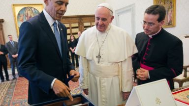 PHOTO: President Barack Obama presents his gift to Pope Francis, March 27, 2014, at the Vatican.