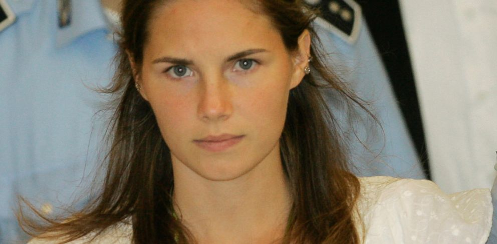 PHOTO: Amanda Knox is escorted by Italian penitentiary police officers from Perugias court after a hearing, Sept. 16, 2008.