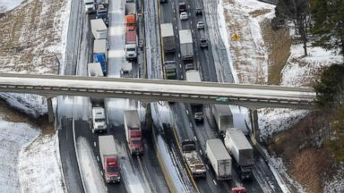 PHOTO: Vehicles are stranded along Interstate 20, Jan. 29, 2014, near Pell City, Ala.