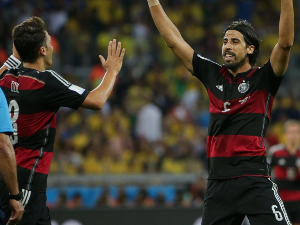 PHOTO: Germanys Sami Khedira, right, celebrates after scoring his goal during the World Cup semifinal soccer match between Brazil and Germany in Belo Horizonte, Brazil on July 8, 2014.