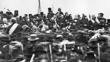 PHOTO: President Abraham Lincoln, center with no hat, surrounded by the crowd at Gettysburg