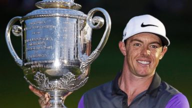 PHOTO: Rory McIlroy, of Northern Ireland, holds up the Wanamaker Trophy after winning the PGA Championship golf tournament at Valhalla Golf Club, Aug. 10, 2014, in Louisville, Ky.