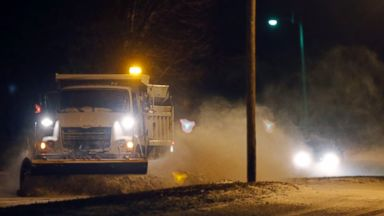 PHOTO: A city snow plow clears drifts of snow along Kasold Drive in Lawrence, Kan., Jan. 1, 2014.