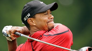PHOTO: Tiger Woods watches his tee shot on the fourth hole during the final round of the Bridgestone Invitational golf tournament on Aug. 3, 2014, at Firestone Country Club in Akron, Ohio.