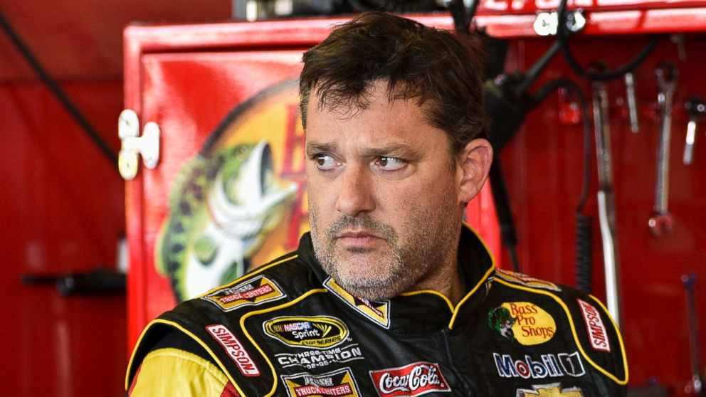 PHOTO: Tony Stewart stands in the garage area after a practice session for Sundays NASCAR Sprint Cup Series auto race at Watkins Glen International, in Watkins Glen N.Y., Aug. 8, 2014.
