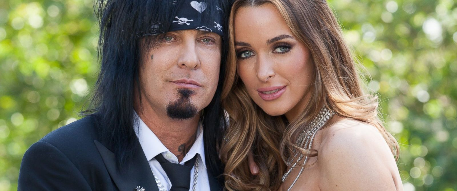 PHOTO: Nikki Sixx, left and Courtney Bingham pose for portraits during their wedding at Greystone Mansion, March 15, 2014 in Beverly Hills, Calif.