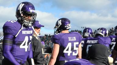 PHOTO: Northwestern Wildcats try to stay warm by heaters during a game against the Michigan State Spartans, Nov. 23, 2013 at Ryan Field in Evanston, Ill.