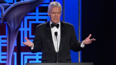 PHOTO: Game show host Alex Trebek addresses the audience at the 2014 Writers Guild Award Ceremony at JW Marriott Los Angeles at L.A. LIVE, Feb. 1, 2014 in Los Angeles.