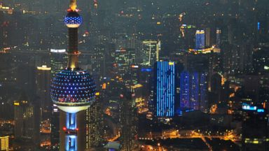 PHOTO: The Oriental Pearl TV Tower is illuminated in blue on World Autism Awareness Day, April 2, 2013, in Shanghai.