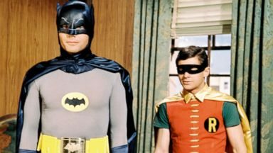PHOTO: Adam West and Burt Ward, both in costume as the Dynamic Duo in a publicity still issued for the television series, Batman, circa 1966.