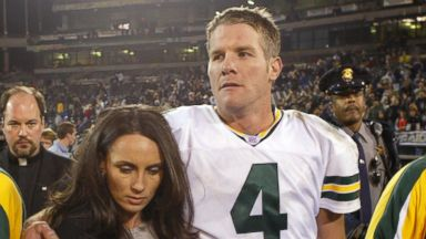 PHOTO: Brett Favre #4 of the Green Bay Packers leaves the field with his wife Deanne after defeating the Oakland Raiders after an NFL game in this Dec. 22, 2003, file photo at the Network Associates Coliseum in Oakland, Calif.