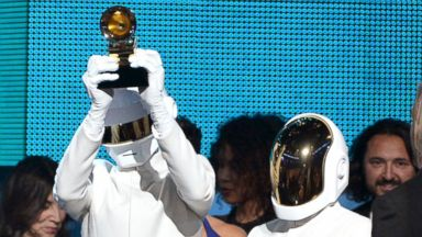 PHOTO: Daft Punk accepts the award for Album of the Year onstage during the 56th GRAMMY Awards at Staples Center in Los Angeles, Jan. 26, 2014.