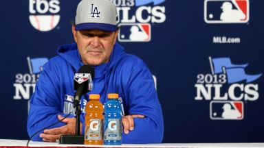PHOTO: Manager Don Mattingly of the Los Angeles Dodgers answers questions before Game Six of the National League Championship Series against the St. Louis Cardinals at Busch Stadium, Oct. 18, 2013, in St Louis.