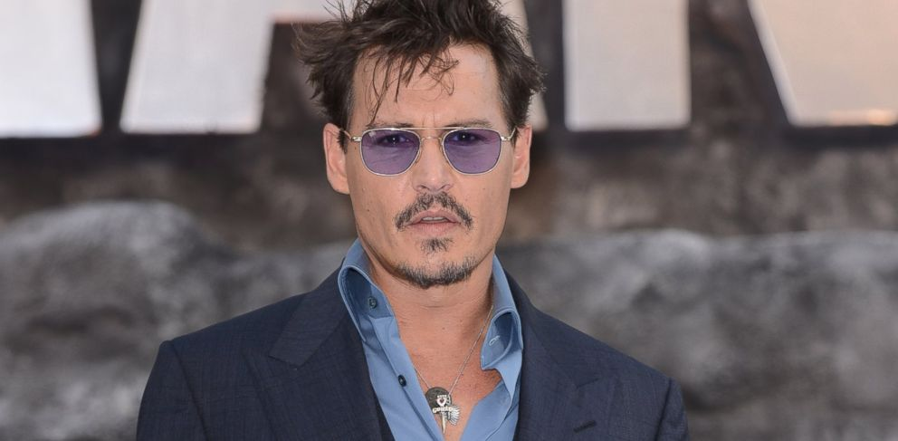 PHOTO: Johnny Depp attends the UK Premiere of The Lone Ranger at Odeon Leicester Square, July 21, 2013 in London.