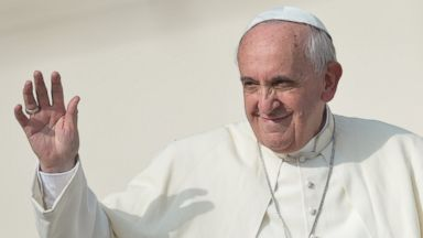 PHOTO: Pope Francis greets the crowd after his general audience at St Peters square on Oct. 30, 2013 at the Vatican.