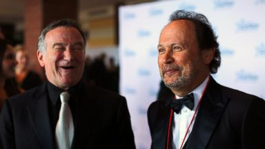 "PHOTO: Comedians Robin Williams and Billy Crystal talk with reporters on the red carpet before the 2012 Starkey Hearing Foundations ""So the World May Hear Awards Gala, in this file photo Aug. 4, 2012 in St. Paul, Minn."