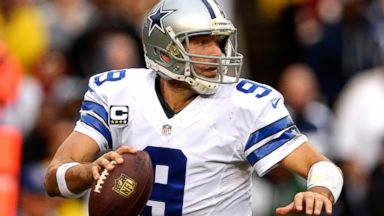 PHOTO: Quarterback Tony Romo #9 of the Dallas Cowboys scrambles with the ball in the second half during an NFL game against the Washington Redskins on Dec. 22, 2013 in Landover, Md.