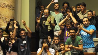 PHOTO: People celebrate after the Uruguayan senate approved a law legalizing marijuana in the Legislative Palace in Montevideo, Dec. 10, 2013.