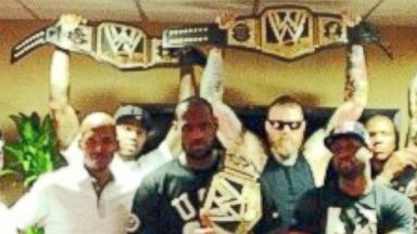 PHOTO: LeBron James surprised his teammates with WWE championship belts, Feb. 26, 2014.