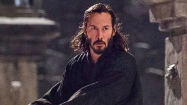 "PHOTO: Kai (Keanu Reeves) protects Mika (Ko Shibasaki) in the action-adventure ""47 Ronin."""