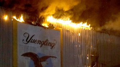 PHOTO: A fire burns at the Yuengling brewery in Tampa, Fla., Oct. 26, 2013.