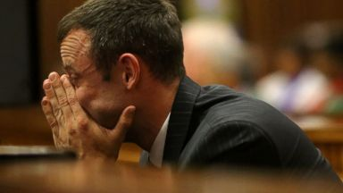 PHOTO: Oscar Pistorius sits in the dock as he listens to cross questioning in court during his trial in Pretoria, South Africa, March 10, 2014.