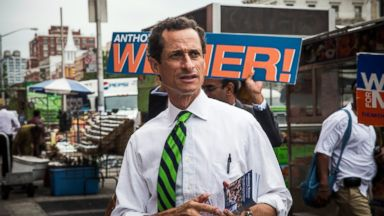 PHOTO: New York City mayoral hopeful Anthony Weiner meets with people on a street corner In Harlem in this September 10, 2013 file photo taken in New York City.