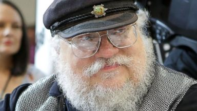 "PHOTO: Writer George R.R. Martin of ""Game of Thrones"" signs autographs during the 2014 Comic-Con International Convention-Day on July 25, 2014 in San Diego, Calif."