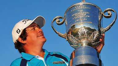 PHOTO: Jason Dufner poses with the Wanamaker Trophy after his two-stroke victory at the 95th PGA Championship at Oak Hill Country Club on Aug. 11, 2013 in Rochester, N.Y.