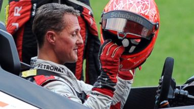 PHOTO: German Formula One driver Michael Schumacher puts on a helmet during a practice session ahead of the annual Race of Champions in Bangkok, in this Dec. 15, 2012 photo.
