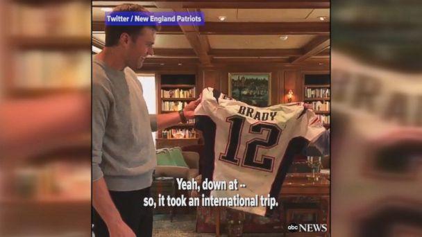 New England Patriots owner Robert Kraft presents Tom Brady with his stolen Super Bowl jerseys.