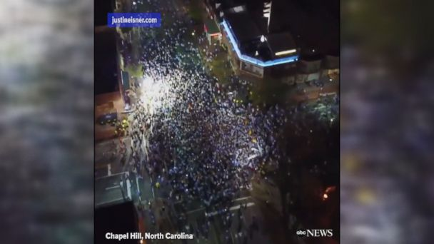 Drone footage shows fans rushing Franklin Street in Chapel Hill after the University of North Carolina defeated Gonzaga to win the NCAA national men's basketball championship.