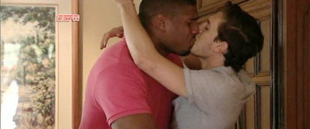 PHOTO: Michael Sam kisses his boyfriend, Vito Cammisano, after getting a call from the St. Louis Rams, May 10, 2014.