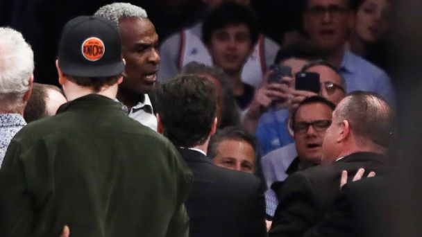 PHOTO: Former New York Knicks player Charles Oakley exchanges words with a security guard during the first half of an NBA basketball game between the New York Knicks and the LA Clippers, Feb. 8, 2017, in New York.