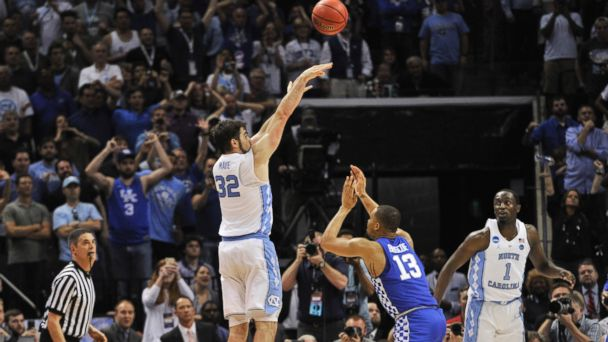 PHOTO: North Carolina forward Luke Maye shoots the winning basket as Kentucky guard Isaiah Briscoe defends in the second half of the South Regional final game in the NCAA college basketball tournament on March 26, 2017, in Memphis, Tenn.