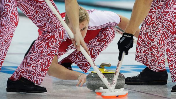 PHOTO: Russias Alexey Stukalskiy watches the stone as his teammates sweep the ice during the first day of the mens curling training at the 2014 Winter Olympics, Saturday, Feb. 8, 2014, in Sochi, Russia.